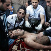 A man, who gave his name as Maged Mahmoud, is tended to after he was injured during clashes with riot police in Cairo, Egypt, Friday, Jan. 28, 2011. (AP Photo/Ben Curtis)