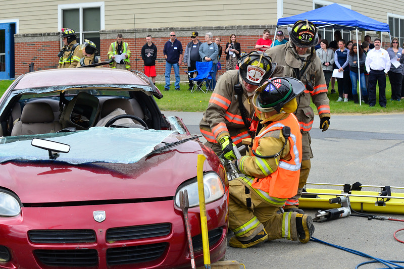 "KRISTOPHER RADDER - BRATTLEBORO REFORMER<br /> Victoria Gassett, an ELO Student at Hinsdale High School, works alongside the Brattleboro Fire Department using the ""jaws of life"" during a demonstration of a vehicle accident on Friday, May 12, 2017."