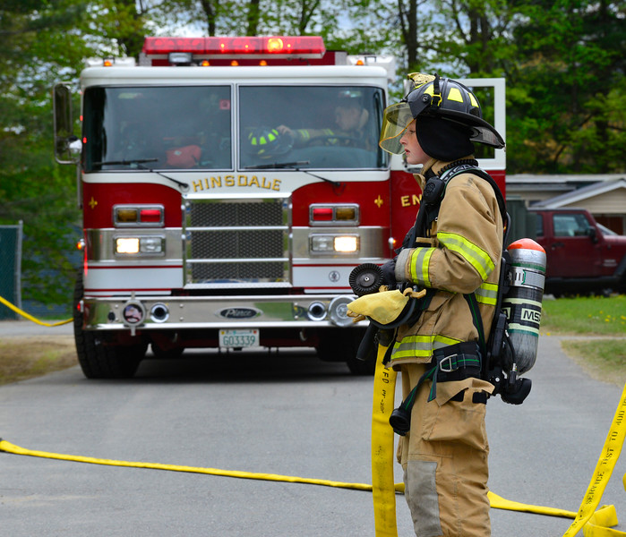 KRISTOPHER RADDER - BRATTLEBORO REFORMER<br /> Zachary Gassett, an ELO Student at Hinsdale High School, mans the hose during a demonstration of a vehicle accident on Friday, May 12, 2017.