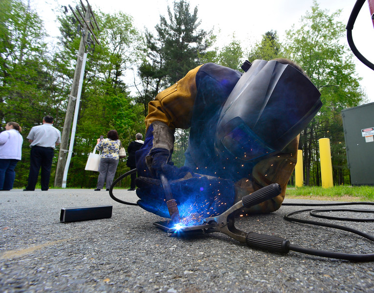 KRISTOPHER RADDER - BRATTLEBORO REFORMER<br /> Eric Patch, an ELO Student at Hinsdale High School, shows a group how to tack weld during one of 15 various demonstrations that showcased the skills ELO students have learned on Friday, May 12, 2017.