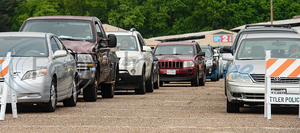Hundreds of cars are queued to participate in the East Texas Food Bank drive-thru emergency food box distribution in response to COVID-19 in Tyler, Texas on Friday, April 3, 2020. According to officials from the East Texas Food Bank, 840 households were served in the drive-thru with 1680 gallons of milk and 13,440 meals.