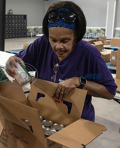 Sharon Higgins of Tyler volunteers at the East Texas Food Bank with others from the East Texas Lighthouse for the Blind (ETLB) on Monday, Nov. 25, 2019. East Texas Lighthouse for the Blind is a 501c3 non-profit organization, which was created in 1976 to serve the needs of the blind and visually impaired. The mission of The Lighthouse is to empower blind Americans through rehabilitation, education, training, and employment leading to a fully independent lifestyle.   (Sarah A. Miller/Tyler Morning Telegraph)
