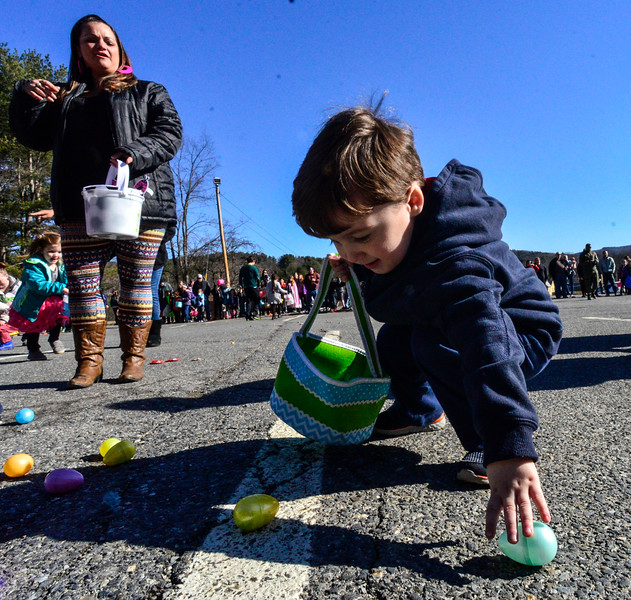 KRISTOPHER RADDER - BRATTLEBORO REFORMER<br /> Kai Stimulus, 3, reaches for  an egg during the annual Recreation Department's Easter Egg Hunt on Saturday, March 31, 2018.