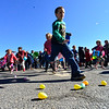 KRISTOPHER RADDER - BRATTLEBORO REFORMER<br /> The older group of children rushes to grab as many eggs during the annual Recreation Department's Easter Egg Hunt on Saturday, March 31, 2018.
