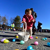 KRISTOPHER RADDER - BRATTLEBORO REFORMER<br /> Surrounded by eggs, Olliara Winter, 1, looks for the right one during the annual Recreation Department's Easter Egg Hunt on Saturday, March 31, 2018.