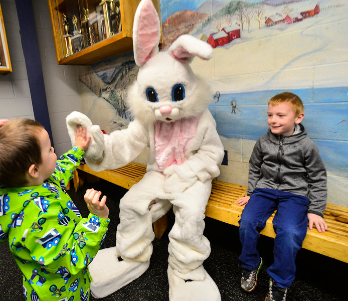 KRISTOPHER RADDER — BRATTLEBORO REFORMER<br /> Gavin Johnson, 3, gives the Easter bunny a high-five during the annual Easter Egg Hunt hosted by the Brattleboro Recreation and Parks Department on Saturday, April 20, 2019.