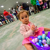KRISTOPHER RADDER — BRATTLEBORO REFORMER<br /> Roselynn Rattanavilay, 2, goes through the eggs that she collected during the annual Easter Egg Hunt hosted by the Brattleboro Recreation and Parks Department on Saturday, April 20, 2019.