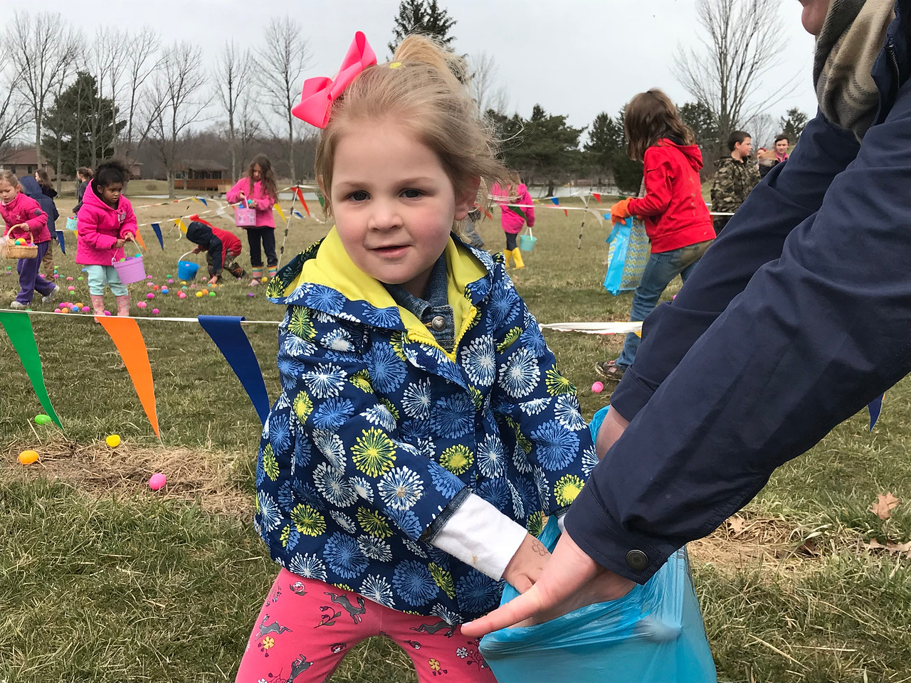 NATHAN HAVENNER / GAZETTE  Kennedy Boyer, 3, goes for an Easter egg during an afternoon hunt at Beriswill Farms on Saturday. The farm at 2200 Station Road, Liverpool Township, has hosted the Easter Egg Hunt and Farm Fun event for families since 2016.