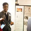 BEN GARVER – THE BERKSHIRE EAGLE<br /> Augustine Asumadu, 17, of Taconic High School invented a working shakeable cell phone charger he presented at the Eighth Annual Science and Innovation Fair at the Berkshire Museum, Tuesday, February 13, 2018. Asumadu was inspired by the fact that such a device could save lives during diasters such as wildfires or the recent storm devistation in Puerto Rico.