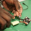 BEN GARVER – THE BERKSHIRE EAGLE<br /> Augustine Asumadu, 17, of Taconic High School invented a working shakeable cell phone charger (detail) he presented at the Eighth Annual Science and Innovation Fair at the Berkshire Museum, Tuesday, February 13, 2018. Asumadu was inspired by the fact that such a device could save lives during diasters such as wildfires or the recent storm devistation in Puerto Rico.