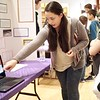 BEN GARVER – THE BERKSHIRE EAGLE <br /> Geneviere Brites,  15 of Pittsfield High School, present her science project to fifth graders at the Berkshire Museum. Geneviere Brites and Gwyneth Smith studied the ability of gummy bears to absorb liquids.