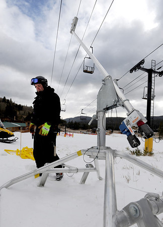 """Derek Holden walks by one of the new snow making guns on Thursday.<br /> Eldora Mountain Resort will open on Friday, November 16, 2012.<br /> For more photos and a video from Eldora, go to  <a href=""""http://www.dailycamera.com"""">http://www.dailycamera.com</a><br /> Cliff Grassmick  / November 15, 2012"""