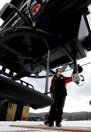 """Sean Pine operates the Eldora chairlift for employees working on the slope on Thursday.<br /> Eldora Mountain Resort will open on Friday, November 16, 2012.<br /> For more photos and a video from Eldora, go to  <a href=""""http://www.dailycamera.com"""">http://www.dailycamera.com</a><br /> Cliff Grassmick  / November 15, 2012"""
