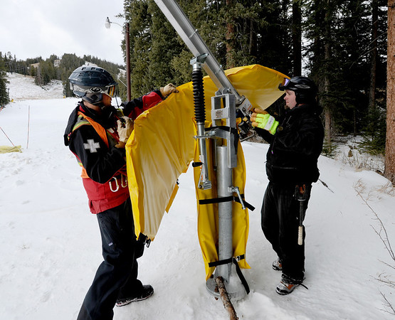 "Nick Sprague, left, and Derek Holden, put protective padding on a snow makers device on Thursday.<br /> Eldora Mountain Resort will open on Friday, November 16, 2012.<br /> For more photos and a video from Eldora, go to  <a href=""http://www.dailycamera.com"">http://www.dailycamera.com</a><br /> Cliff Grassmick  / November 15, 2012"