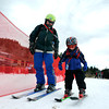 "Carl Swanson and his 4-year-old son Tobin, of Longmont, work their way towards the chairlift on opening day on Friday, Nov. 16, at Eldora Mountain Resort. For more photos and video of opening day go to  <a href=""http://www.dailycamera.com"">http://www.dailycamera.com</a><br /> Jeremy Papasso/ Camera"