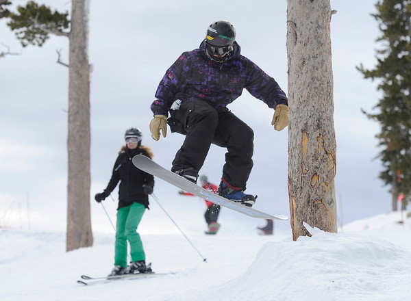 "Corey Kaufer, of Nederland, catches some air while snowboarding during opening day at Eldora Mountain Resort on Friday, Nov. 16. For more photos and video of opening day go to  <a href=""http://www.dailycamera.com"">http://www.dailycamera.com</a><br /> Jeremy Papasso/ Camera"