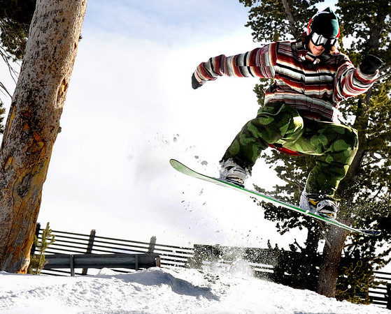 "Nick Wramage, 20, of Boulder,  throws down a backside-180 while shredding the fresh snow on the opening day of Eldora Ski Resort on Friday, Nov. 19, in Nederland.<br /> For more photos and video of opening day go to  <a href=""http://www.dailycamera.com"">http://www.dailycamera.com</a><br /> Jeremy Papasso"