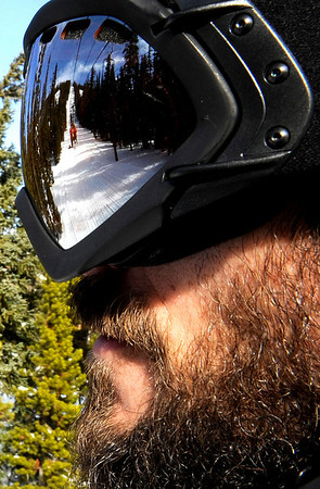 """The freshly groomed slopes reflect in the goggles of Eric Anielski, of Nederland, while riding the chairlift during the opening day of Eldora Ski Resort on Friday, Nov. 19, in Nederland.<br /> For more photos and video of opening day go to  <a href=""""http://www.dailycamera.com"""">http://www.dailycamera.com</a><br /> Jeremy Papasso"""
