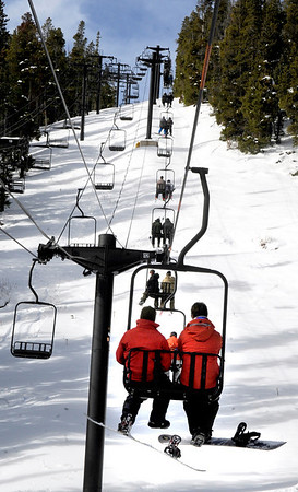 "Snowboarders and skiers ride the chairlift during the opening day of Eldora Ski Resort on Friday, Nov. 19, in Nederland.<br /> For more photos and video of opening day go to  <a href=""http://www.dailycamera.com"">http://www.dailycamera.com</a><br /> Jeremy Papasso"
