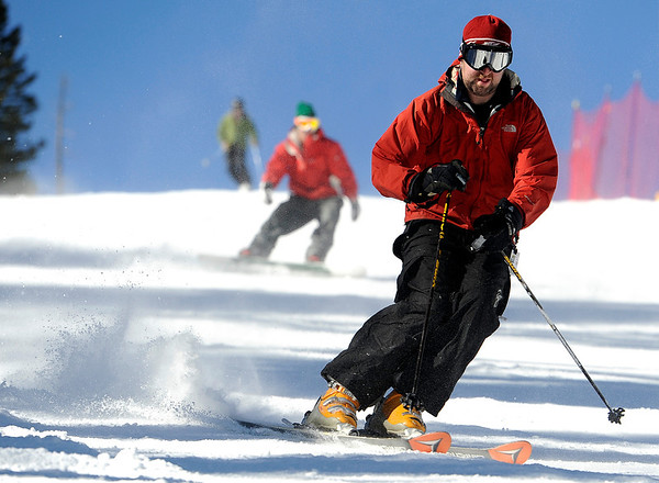 """An unidentified skier carves some turns on Friday, Nov. 18, during Eldora Mountain Resort's opening day. For more photos and video of opening day go to  <a href=""""http://www.dailycamera.com"""">http://www.dailycamera.com</a><br /> Jeremy Papasso/ Camera"""