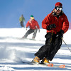 "An unidentified skier carves some turns on Friday, Nov. 18, during Eldora Mountain Resort's opening day. For more photos and video of opening day go to  <a href=""http://www.dailycamera.com"">http://www.dailycamera.com</a><br /> Jeremy Papasso/ Camera"