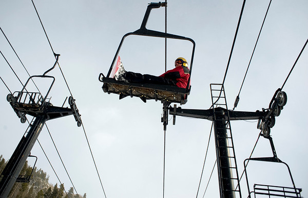 A snowboarder sits back to enjoy the view on the way up the slop at Eldora Ski Resort near Nederland, Thursday, Dec. 17, 2009. Eldora is seeing better and more snow than usual, and is working on opening up terrain parks and back bowls early this season. <br />  <br /> KASIA BROUSSALIAN
