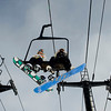 Two snowboarders chat on the way up to the top of the mountain at Eldora Ski Resort near Nederland, Thursday, Dec. 17, 2009. Eldora is seeing better and more snow than usual, and is working on opening up terrain parks and back bowls early this season. <br />  <br /> KASIA BROUSSALIAN