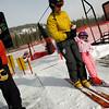 Eldora lift operator Patrick Knight watches as Mike Moore, of Lafayette, lifts his daughter, Dylan, 3, onto the chair lift at Eldora Ski Resort near Nederland, Thursday, Dec. 17, 2009. Eldora is seeing better and more snow than usual, and is working on opening up terrain parks and back bowls early this season. <br />  <br /> KASIA BROUSSALIAN