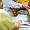 KRISTOPHER RADDER — BRATTLEBORO REFORMER<br /> Richard Johnson, moderator for Hinsdale, N.H., dumps out the ballots from the box as they start to hand count the hundreds of ballots during the 2018 Midterm elections on Tuesday, Nov. 6.