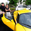 "Rob Seski, left, explains the details of the Tesla car to Mark Leachman and his wife Heidi, of Superior, on Thursday, May 17, during the electric vehicle expo outside of the Wolf Law building on the University of Colorado campus in Boulder. For more photos and video of the event go to  <a href=""http://www.dailycamera.com"">http://www.dailycamera.com</a><br /> Jeremy Papasso/ Boulder Daily Camera"