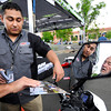"Grand Prix Motorsports employee Angel Macias, left, talks with Bill Ingalls, of Boulder, about the Zero XU Urban Crosser electric motorcycle on Thursday, May 17, during the electric vehicle expo outside of the Wolf Law building on the University of Colorado campus in Boulder. For more photos and video of the event go to  <a href=""http://www.dailycamera.com"">http://www.dailycamera.com</a><br /> Jeremy Papasso/ Boulder Daily Camera"
