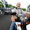 "Bill Ingalls, of Boulder, sits on the Zero XU Urban Crosser electric motorcycle on Thursday, May 17, during the electric vehicle expo outside of the Wolf Law building on the University of Colorado campus in Boulder. For more photos and video of the event go to  <a href=""http://www.dailycamera.com"">http://www.dailycamera.com</a><br /> Jeremy Papasso/ Boulder Daily Camera"