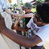 Globe/T. Rob Brown<br /> Kenny Chinnam, 13, (right) and Glenn Johnston, 16, both members of the First United Methodist Church youth group from Elgin, Ill., install siding on a Rebuild Joplin home being built for Emily Morrison, Thursday morning, June 13, 2013.