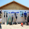 Globe/T. Rob Brown<br /> Youths from First United Methodist Church in Elgin, Ill., continue to construct a Rebuild Joplin home for Emily Morrison, Thursday morning, June 13, 2013.