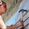 Globe/T. Rob Brown<br /> Paige VanDerStuyf, 16, from First United Methodist Church in Elgin, Ill., hammers a nail into siding for a Rebuild Joplin home for Emily Morrison, Thursday morning, June 13, 2013.