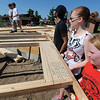 Globe/T. Rob Brown<br /> Youth from First United Methodist Church in Elgin, Ill., lift one of several pre-constructed frame pieces Monday morning, June 10, 2013, for Emily Morrison's Joplin home. The youth group is working in conjunction with Rebuild Joplin.