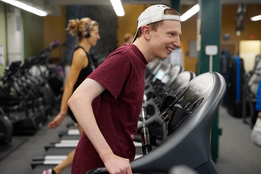 . Elijah McBurney works on a treadmill at Berkshire Nautilus in Pittsfield.  Elijah is a 20 year-old man with a degenerative brain disorder called BPAN that is extremely rare. Thursday, October 27, 2016. Ben Garver � The Berkshire Eagle