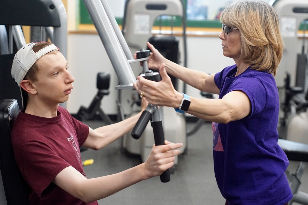 . Elijah McBurney works with his mother Donna at Berkshire Nautilus, building strong muscle and range of motion that might forestall the progression of Elijah\'s rare neurodegenerative disease, BPAN. Thursday, October 27, 2016. Ben Garver � The Berkshire Eagle