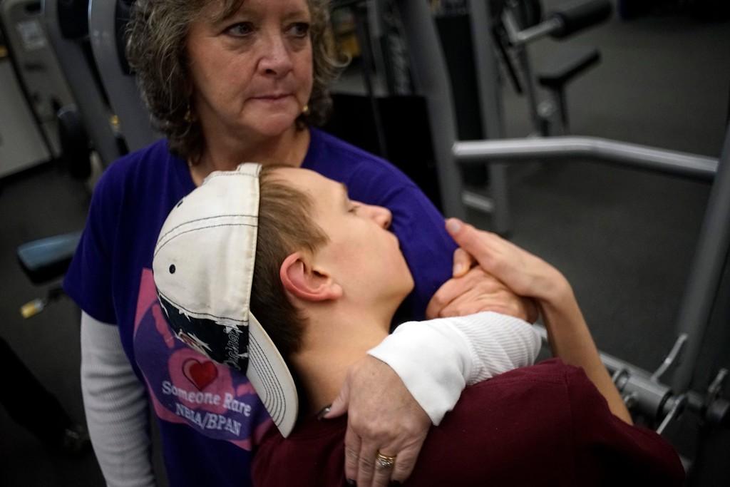 . Elijah McBurney hugs his one-on-one helper Debbie Laframboise during a busy morning, Thursday, October 27, 2016. Ben Garver � The Berkshire Eagle