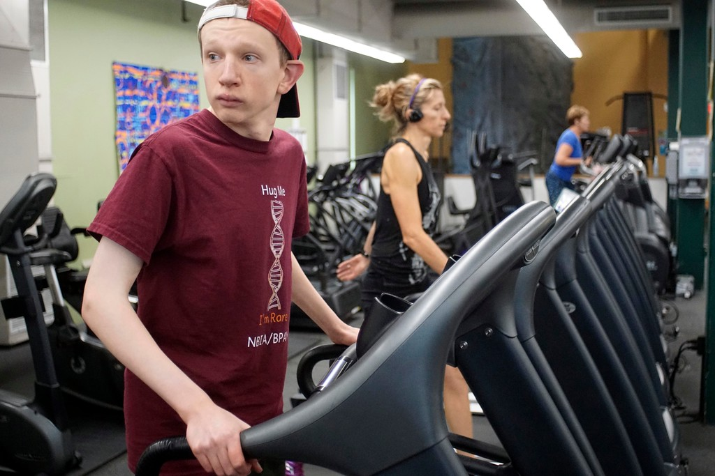 . Elijah McBurney works out a treadmill at Berkshire Nautilus in Pittsfield.  Elijah is a 20 year-old man with a degenerative brain disorder called BPAN that is extremely rare. Thursday, October 27, 2016. Ben Garver � The Berkshire Eagle