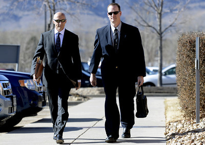 0207CURNOW.jpg Former Boulder Police Officer Brent Curnow, right, walks with his lawyer Patrick Mulligan to the Boulder County Jail for filing of charges in the case of the Mapleton Hill elk shooting in Boulder, Colorado February 7, 2013. DAILY CAMERA/ Jeremy Papasso