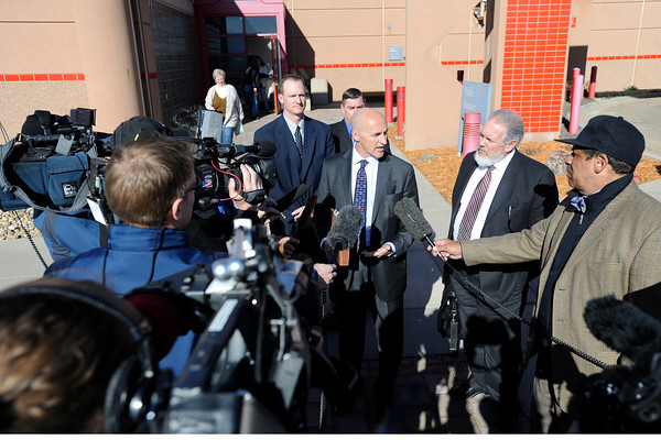 "Attorney's Marc Colin, right, and Patrick Mulligan, center, talk with reporters while standing with former Boulder Police officers Brent Curnow, left, and Samuel Carter, back, during the filing of charges on Thursday, Feb. 7, at the Boulder County Jail. Carter and Curnow, not pictured, are being charged for the killing of a bull elk on Mapelton Avenue in Boulder. For more photos and video of the filing of charges go to  <a href=""http://www.dailycamera.com"">http://www.dailycamera.com</a><br /> Jeremy Papasso/ Camera"