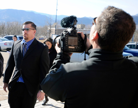 """Former Boulder Police Samuel Carter, left, walks past the media into the Boulder County Jail during the filing of charges on Thursday, Feb. 7, at the Boulder County Jail. Carter and Brent Curnow, not pictured, are being charged for the killing of a bull elk on Mapelton Avenue in Boulder. For more photos and video of the filing of charges go to  <a href=""""http://www.dailycamera.com"""">http://www.dailycamera.com</a><br /> Jeremy Papasso/ Camera"""