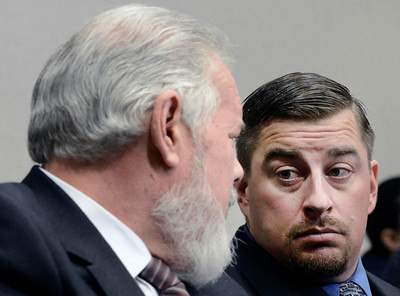 Attorney Marc Colin, left, talks with former Boulder Police officer Sam Carter during the filing of charges on Thursday, Feb. 7, at the Boulder County Jail. Carter and Brent Curnow, not pictured, are being charged for the killing of a bull elk on Mapelton Avenue in Boulder. For more photos and video of the filing of charges go to www.dailycamera.com Jeremy Papasso/ Camera