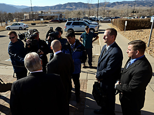 "Former Boulder Police Officers Samuel Carter, right, and Brent Curnow listen as their lawyers, Patrick Mulligan, center, and Marc Colin, left, give a statement outside the Boulder County Jail after the filing of charges in the case of the Mapleton Hill elk shooting in Boulder on Thursday, Feb. 7, 2013. For more photos and a video visit  <a href=""http://www.DailyCamera.com"">http://www.DailyCamera.com</a>.<br /> (Greg Lindstrom/Times-Call)"