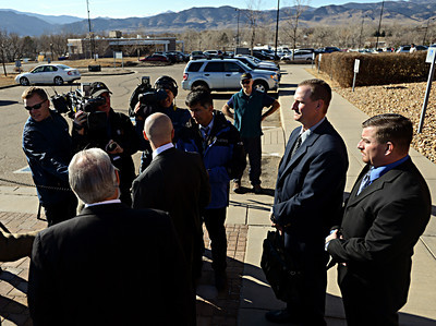 Former Boulder Police Officers Samuel Carter, right, and Brent Curnow listen as their lawyers, Patrick Mulligan, center, and Marc Colin, left, give a statement outside the Boulder County Jail after the filing of charges in the case of the Mapleton Hill elk shooting in Boulder on Thursday, Feb. 7, 2013. For more photos and a video visit www.DailyCamera.com. (Greg Lindstrom/Times-Call)
