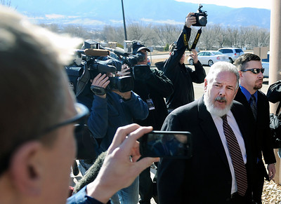 Attorney Marc Colin, center, talks with reporters while walking next to former Boulder Police officer Samuel Carter, right, during the filing of charges on Thursday, Feb. 7, at the Boulder County Jail. Carter and Brent Curnow, not pictured, are being charged for the killing of a bull elk on Mapelton Avenue in Boulder. For more photos and video of the filing of charges go to www.dailycamera.com Jeremy Papasso/ Camera