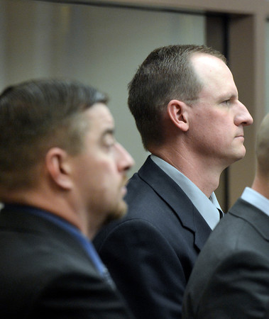 "Former Boulder Police officers Sam Carter, left, and Brent Curnow listen to the judge during the filing of charges on Thursday, Feb. 7, at the Boulder County Jail. Carter and Curnow are being charged for the killing of a bull elk on Mapelton Avenue in Boulder. For more photos and video of the filing of charges go to  <a href=""http://www.dailycamera.com"">http://www.dailycamera.com</a><br /> Jeremy Papasso/ Camera"