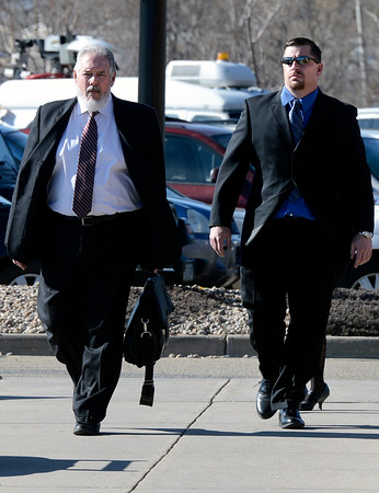 "Former Boulder Police officer Sam Carter, right, walks with his attorney Marc Colin into the Boulder County Jail for the filing of charges on Thursday, Feb. 7, at the Boulder County Jail. Carter and fellow officer Brent Curnow, not pictured, are being charged for killing an bull elk on Mapleton Avenue in Boulder. For more photos and video of the filing of charges go to  <a href=""http://www.dailycamera.com"">http://www.dailycamera.com</a><br /> Jeremy Papasso/ Camera"