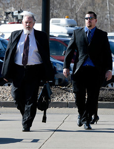 Former Boulder Police officer Sam Carter, right, walks with his attorney Marc Colin into the Boulder County Jail for the filing of charges on Thursday, Feb. 7, at the Boulder County Jail. Carter and fellow officer Brent Curnow, not pictured, are being charged for killing an bull elk on Mapleton Avenue in Boulder. For more photos and video of the filing of charges go to www.dailycamera.com Jeremy Papasso/ Camera